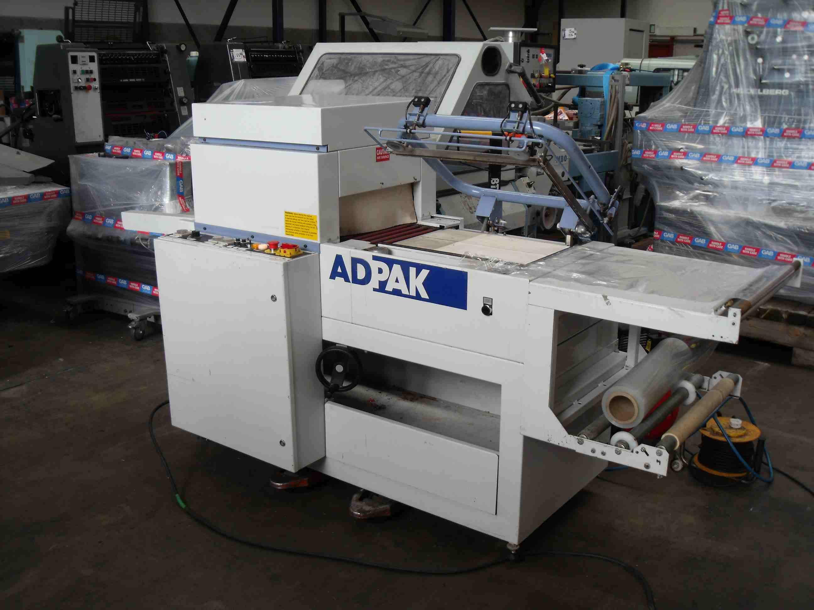 ADPAK SHIRNK WRAPPING MACHINE