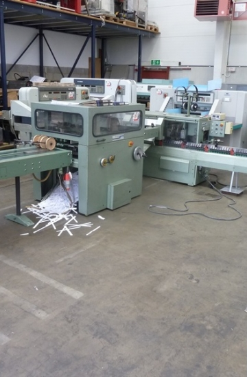 Saddle Stitching  Used finishing machines Muller Martini 1509 saddle stitcher with three knife trimmer