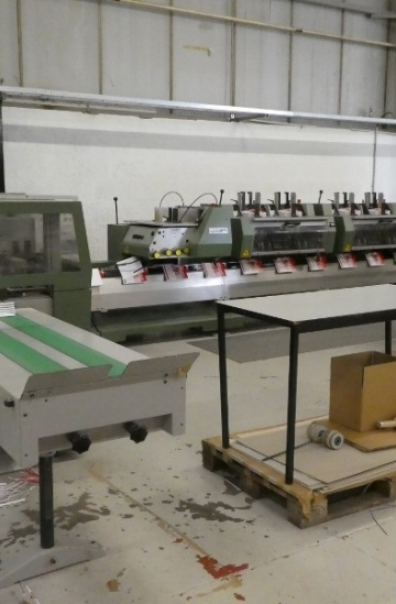 Saddle Stitching  Used finishing machines Muller Martini Valore Saddle Stitcher with 6 stations and cover