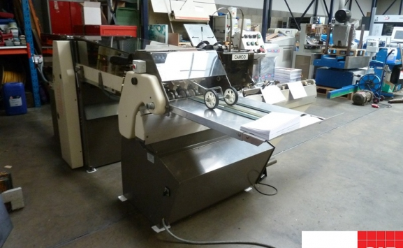 Rosback twin haed saddle stitcher with on-line trimmer